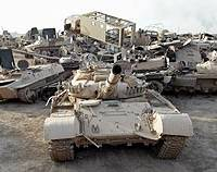 Iraqi armor in a Baghdad dump in June 2003. Some of the vehicles may have been hit by the depleted-uranium munitions Gerard Matthew blames for his and his daughter's affliction.