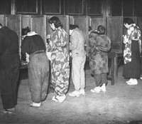 Women in Tokyo vote in the April 10, 1946, Lower House election, the first in which they could take part.