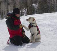 A rescue dog and his handler take a break at a dog school in Utah.