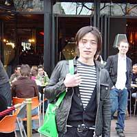 Takumi Sawada outside one of the Parisian cafes he loves.