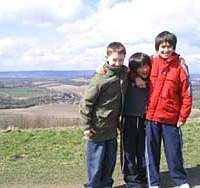 The young Honeys with a friend (left) on hills near home