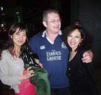 Two locals get acquainted with a Scot's bagpipes in a Tokyo pub the night before May 13's Japan-Scotland Kirin Cup 0-0 draw that was enough to make Scotland the overall Kirin Cup winners.