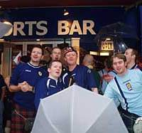 Scotland fans gather outside a sports bar in Tokyo's Roppongi district for a lunchtime pint or five prior to the Japan-Scotland game in Saitama.