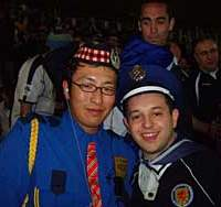 A Scottish fan and a stadium security official swap hats before the Japan-Scotland match.