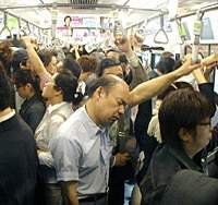 Straphangers on a rush-hour Yamanote Line train