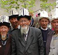 Wizened gents at an election rally on the outskirts of Osh for crime-boss political candidate Sanshar Kadyralev. The traditional white felt hats especially favored by older men are worn year-round, for their warmth in the brutal winters and as protection from the blistering sun in summer.