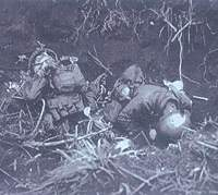 Two of some 20,000 Japanese troops and Korean conscripts killed in the Battle of Iwo Jima (above); U.S. Marine gunners target Mount Suribachi | PHOTOS COURTESY OF SHOGAKUKAN, from