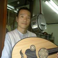 Minoru Fushimi, an English teacher until last year, objected to textbook stereotypes. Now he is Japan's only specialist importer of Middle Eastern musical instruments, many of which are cousins to Japanese instruments. | ANGELA JEFFS PHOTO