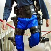 A 'robot suit' in use at the University of Tsukuba in Ibaraki Prefecture north of Tokyo in June 2005. It was developed there to help the aged and disabled to walk, using metal legs and a computer that detects electrical signals in the muscles, then activates motors linked to the legs to support the wearer's movements. | AP PHOTO