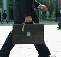 A man with a portable ashtray dangling from his briefcase in a TV advert from Japan Tobacco's current 'Smoking Clean' campaign