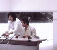Akira Haraguchi (top) at his third pi recitation attempt at an international convention hall in Chiba Prefecture in July 2005, during which his wife Seiko serves him  onigiri  rice balls to keep him going through the night after his 9 a.m. start. Haraguchi unwinds and shows his 'cute' side at his home in Chiba Prefecture.   SHINICHI HAYANO PHOTO; TOMOKO OTAKE PHOTO