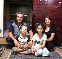Erdal Dogan, his wife Meryem and their children Mehmet and Merve get ready to move out of their Tokyo home and restart their lives this month in Canada, where they have been recognized as refugees. | MASAMI ITO PHOTO
