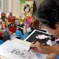 Masamichi Oikawa drawing an illustration of Billy Blanks, of Billy's Bootcamp fame, in his studio in Yamato city, Kanagawa Prefecture. | YOSHIAKI MIURA PHOTO