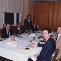 Work and play: Hidetoshi Masunaga (standing) at a meal to celebrate a deal he and colleagues struck with U.S. lawyers in Seattle in 1988. | COURTESY OF HIDETOSHI MASUNAGA