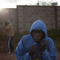 'The Kibera Boxing Team' series features aspiring Kenyan athletes who try to better their lives while living in Nairobi's Kibera slum. | ADRIAN STOREY