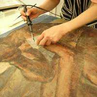 Painstaking work restores a tsunami-damaged painting to its former glory.