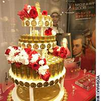VIENNA GOLD coins in the shape of a cake are on display in Tokyo on Feb. 28, a day before the Austrian Mint started selling such coins in Japan.