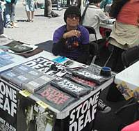 Stone Deaf bassist Kojiro Akai mans his band's booth at Toronto's North By Northwest music festival.
