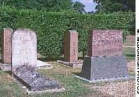 The four graves with the Anglo-Japanese Friendship Association monument.