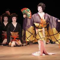 Class act: The renowned geisha Ikuko performing a dance called 'Kodakara Sanbasou.'