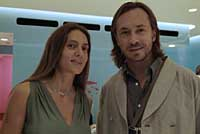 Marie-Helene de Talliac with designer Marc Newson; bottom: part of a display at the new MHT store.