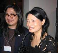 Photographer Wing Shya with Vivienne Tam at the opening of 'Blow up Asia' at the Mori Arts Center in Roppongi.