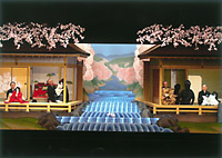 Young lovers Koganosuke and Hinadori live on opposite banks of the Yoshino River (above). Yoshida Bunjaku, shown operating the puppet for Hinadori's mother, Sadaka, first handled the puppet in 1948.   PHOTOS COURTESY OF THE TOKYO NATIONAL THEATER