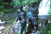 A bronze statue at Kawazu Nanadaru of the student and the dancer of Kawabata's tale
