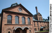 The 19th-century red-brick exterior of the Sapporo Brewery (above); pioneer-style wooden buildings in the botanical garden.
