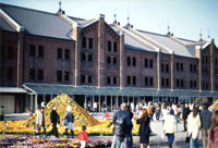 While visitors stroll outside the refurbished Red Brick Warehouse