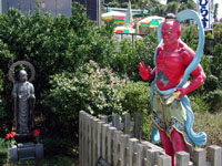 A statue welcomes visitors in Enoshima