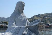 A statue of Murasaki Shikibu stands near the Uji River