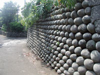 A wall built during the Edo Period from stones carried up from the beaches by convicts