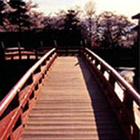 A wooden bridge over the main moat leads to Matsumoto Castle