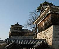 Matsuyama Castle (above); the Botchan Densha (below); and visitors at Isheteji Temple, placing their hands on sand taken from Shikoku's 88 temples (bottom).