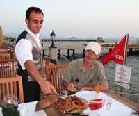 Hugh Paxton in resort-limbo at the Aegean Dream in Turgutreis (above); the gastronomic delights that trapped him there (below); the Turkish castle that looms over the town of Bodrum. | HUGH & MIDORI PAXTON PHOTOS
