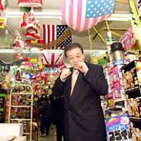 Don Quijote Co. President Takao Yasuda, once a would-be professional boxer, strikes a sparring pose at a company outlet in Edogawa Ward, Tokyo.