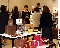 Women shop for chocolates in a Valentine's Day section at the Mitsukoshi department store in Tokyo's Ginza district.