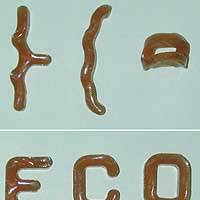 New 'bioplastics,' deformed in the upper photo, return to their original shapes when heated to 60 degrees.   PHOTO COURTESY OF NEC CORP.