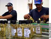 Workers sort bottles of El Jimador at a plant owned by Herradura, one of Mexico's largest tequila exporters, in Amatitan, Jalisco State, in this file photo.