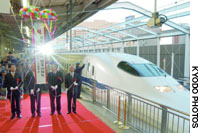 The 40th anniversary of the Tokaido Shinkansen Line is celebrated Friday at JR Shin-Osaka Station (above). Reisuke Ishida, president of the now-privatized Japanese National Railway, cuts a ribbon before the first Hikari train departs JR Tokyo Station on Oct. 1, 1964.
