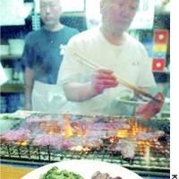 A chef grills beef at a Sendai eatery recently.