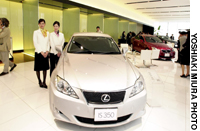 A Lexus luxury sedan from Toyota Motor Corp. is shown off during a preview at a showroom in Tokyo's Minato Ward in May.