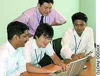 Information-technology engineers from India work with Japanese colleagues at Toppan Printing Co. in Tokyo.