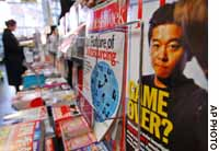 Takafumi Horie, recently arrested founder of Livedoor Co., adorns the cover of a magazine at a Tokyo bookstore.