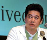 Former Livedoor Co. President Takafumi Horie speaks at a news conference at the company's office in Tokyo on March 23, 2005.
