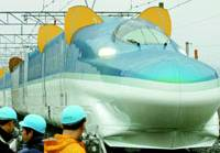 East Japan Railway Co. unveils its next-generation bullet train, Fastech 360 Z, in Rifu, Miyagi Prefecture, with its metal 'ears' -- spoilers used for emergency braking -- deployed.