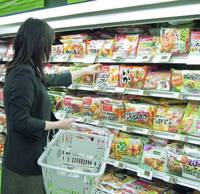 A shopper checks out the frozen food at a supermarket in Tokyo's Meguro Ward.