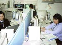 Computer support staff stand by at NEC Corp.'s customer support center in Tokyo in April.