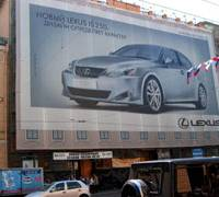 An advertisement for Toyota Motor Corp.'s Lexus IS 250 luxury sedan covers the side of a building on Nevsky Avenue in St. Petersburg, Russia, recently.